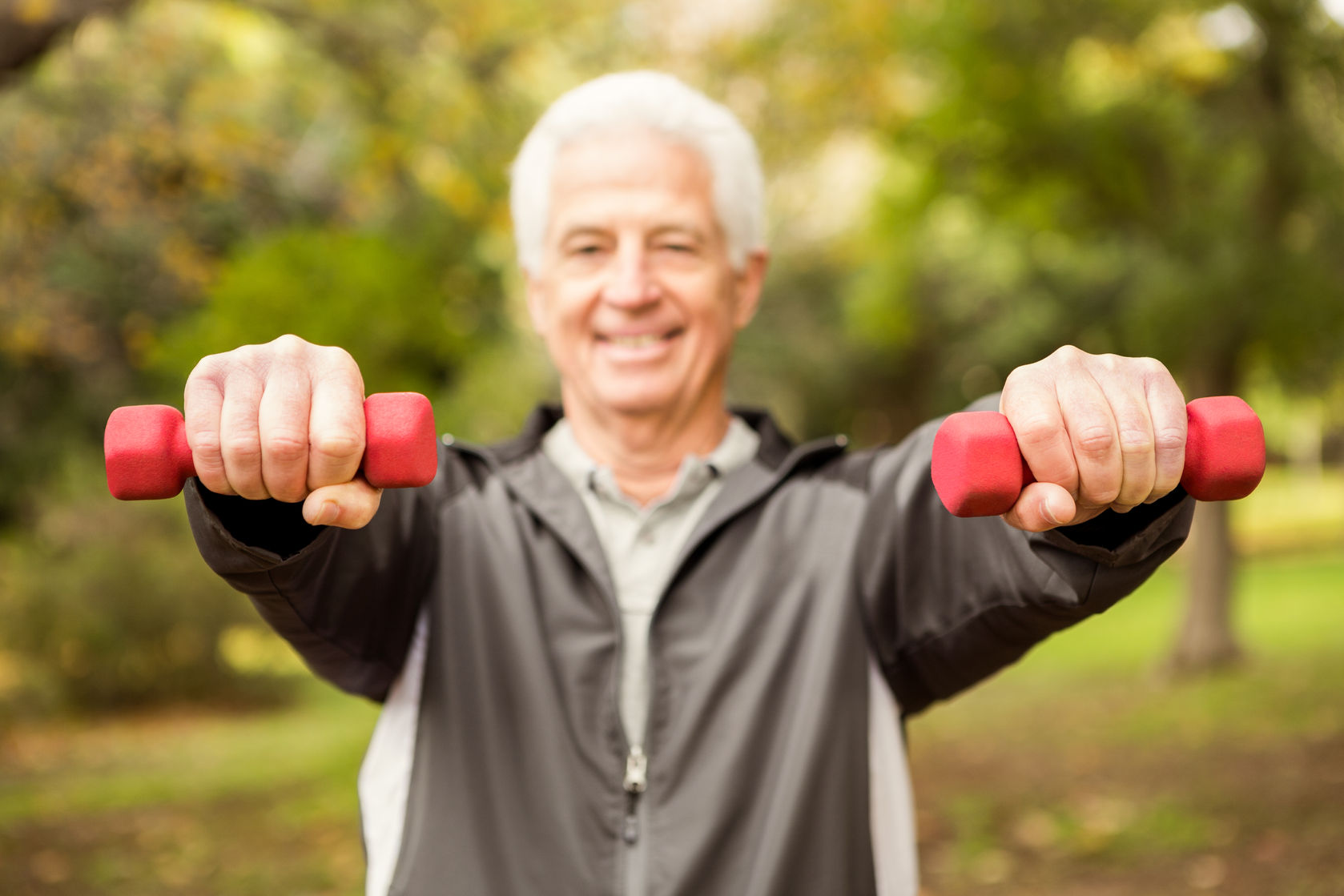 46688125 - senior man working out in park on an autumns day